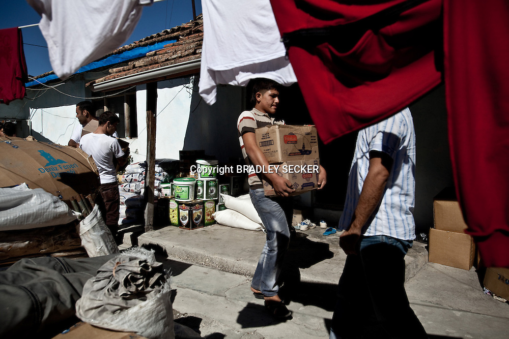 Syrian humanitarian workers in Guvecci, southern Turkey, prepare food and medicine for transportation across the border to Syria. The food and medical supplies are gathered in Turkey, and then taken to field hospitals in Syria, and to displaced civilians fleeing violence. 19/10/2012