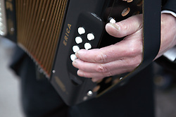 Close up of hand playing accordion,