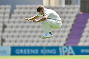 Sam Curran of Surrey leaps in the air while warming up to bowl during the Specsavers County Champ Div 1 match between Hampshire County Cricket Club and Surrey County Cricket Club at the Ageas Bowl, Southampton, United Kingdom on 11 June 2018. Picture by Graham Hunt.