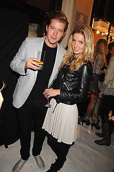Actress ANNABELLE WALLIS and ROBIN SCOTT-LAWSON at a party to celebrate the opening of the new Beatrix Ong store in Burlington Arcade, Piccadilly, London on 14th November 2007.<br />