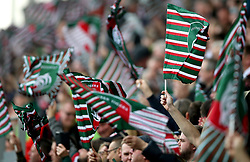 Leicester Tigers supporters in the stands wave flags to show their support during the Aviva Premiership match at Welford Road, Leicester.