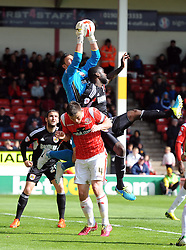 Bristol City's Karleigh Osborne battles for the high ball with Walsall's Richard O'Donnell  - Photo mandatory by-line: Joe Meredith/JMP - Mobile: 07966 386802 12/04/2014 - SPORT - FOOTBALL - Walsall - Banks' Stadium - Walsall v Bristol City - Sky Bet League One