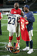 Kansas City Chiefs defensive tackle Jimmy Staten (94) and Los Angeles Rams running back Benny Cunningham (23) swap jerseys and pose for a photograph after the 2016 NFL preseason football game against the Los Angeles Rams on Saturday, Aug. 20, 2016 in Los Angeles. The Rams won the game 21-20. (©Paul Anthony Spinelli)