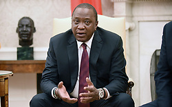 August 27, 2018 - Washington, District of Columbia, U.S. - President Uhuru Kenyatta of Kenya speaks during a bilateral meeting with United States President Donald Trump in the Oval Office of the White House August 27, 2018 in Washington, DC  (Credit Image: © Olivier Douliery/CNP via ZUMA Wire)