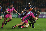 Gloucester prop Josh Hohneck (1) gives a crunching tackle to  Agen no 8 Leo Ghirard(8)  during the European Rugby Challenge Cup match between Gloucester Rugby and SU Agen at the Kingsholm Stadium, Gloucester, United Kingdom on 19 October 2017. Photo by Gary Learmonth.