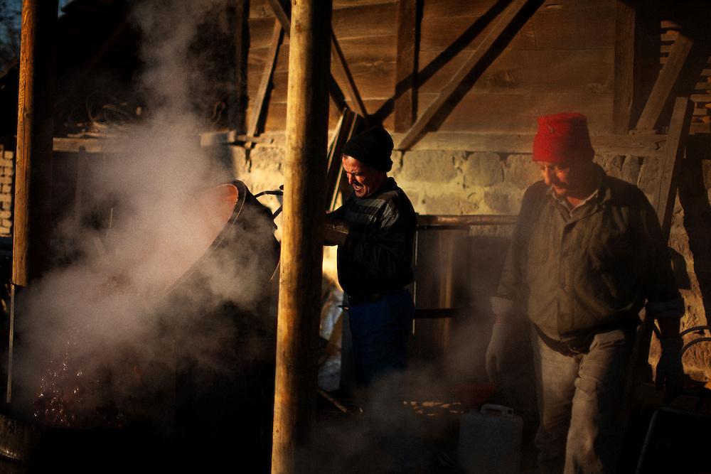 The Colic family making traditional Serbian plum brandy...Rakija Production in Trudelj, Serbia in late November 2011.