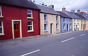 Colourful old terraced cottages in the fishing village of Union Hall, County Cork, Ireland