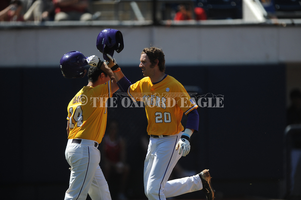 Mississippi vs. LSU's Conner Hale (20) is congratulated following a solo home run by teammate Christian Ibarra (14) at Oxford-University Stadium in Oxford, Miss. on Saturday, April 19, 2014. (AP Photo/Oxford Eagle, Bruce Newman)