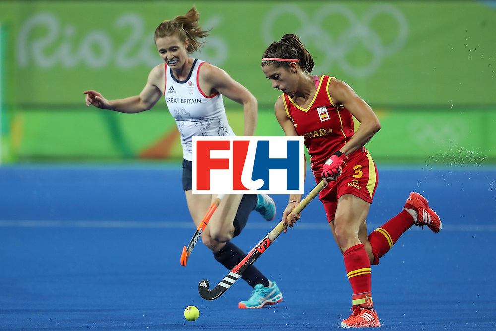 RIO DE JANEIRO, BRAZIL - AUGUST 15:  Rocio Ybarra #3 of Spain moves the ball past Helen Richardson-Walsh #8 of Great Britain during the quarter final hockey game on Day 10 of the Rio 2016 Olympic Games at the Olympic Hockey Centre on August 15, 2016 in Rio de Janeiro, Brazil.  (Photo by Christian Petersen/Getty Images)