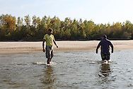 Alex Kahn and OB setting foot on Liberty Island, part of Liberland.