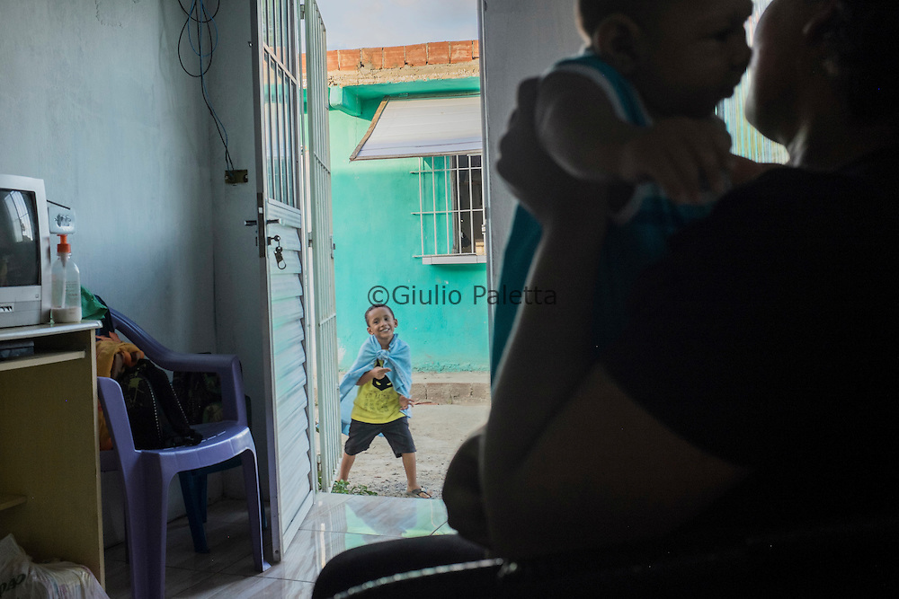 Jaqueline Vieira de Souza (25), with her two sons, João Pedro (4) and Daniel (5 months, born with microcephaly) in their house in Aguas Compridas, a poor neighbourhood of Olinda, Pernambuco
