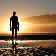 Antony Gormley statue at Another Place on Crosby beach Liverpool