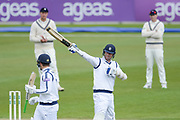 Kyle Abbott of Hampshire raises his bat on reaching his half century during the Specsavers County Champ Div 1 match between Hampshire County Cricket Club and Middlesex County Cricket Club at the Ageas Bowl, Southampton, United Kingdom on 16 April 2017. Photo by David Vokes.