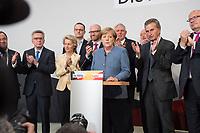 24 SEP 2017, BERLIN/GERMANY:<br /> Angela Merkel (M), CDU, Bundeskanzlerin, eingerahmt von Armin Laschet, Thomas de Maiziere, Ursula von der Leyen, Jens Spahn, Peter Tauber, Karl-Josef Laumann, Dr. Klaus Schueler, Guenther Oettinger, Peter Altmeier, (v.L.n.R.), Wahlparty in der Wahlnacht, Bundestagswahl 2017, Konrad-Adenauer-Haus, CDU Bundesgeschaeftsstelle<br /> IMAGE: 20170924-01-025<br /> KEYWORDS: Election Party, Election Night