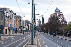 Edinburgh, Scotland, UK. 29 March, 2020. Life in Edinburgh on the first Sunday of the Coronavirus lockdown. Streets deserted, shops and restaurants closed, very little traffic on streets and reduced public transport. Pictured; Princes Street is deserted of traffic and people. Iain Masterton/Alamy Live News