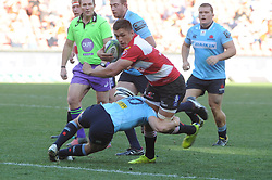 28-07-18 Emirates Airline Park, Johannesburg. Super Rugby semi-final Emirates Lions vs NSW Waratahs. 2nd half. Lions inside centre Harold Vorster tackled by Waratahs lyhalf Bernard Foley (c).<br />  Picture: Karen Sandison/African News Agency (ANA)