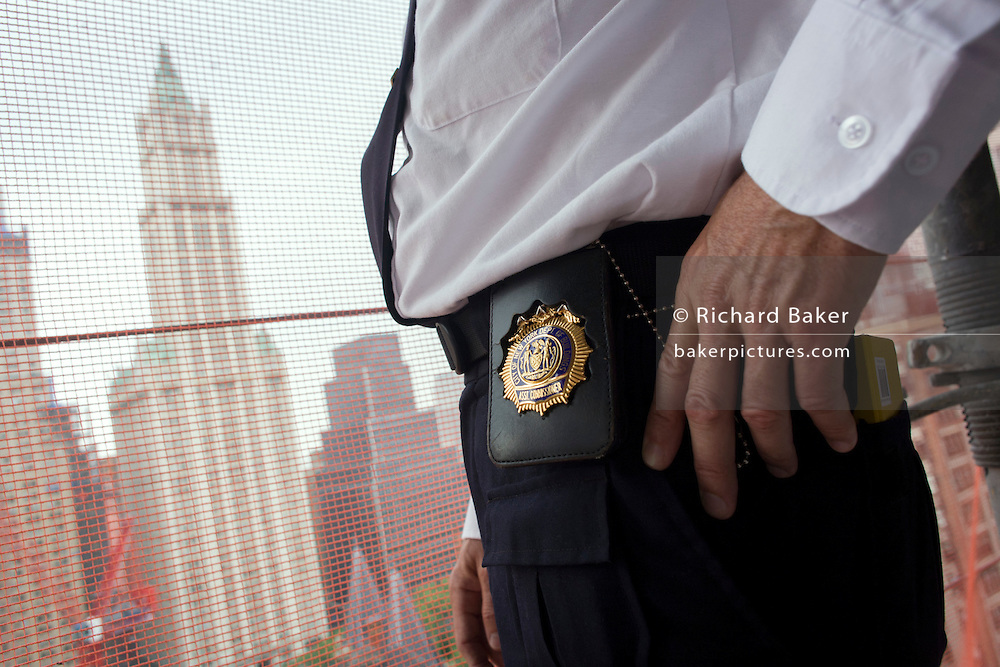 Official NYC shield belonging to Investigative Engineering Services, Assistant Commissioner Tim Lynch inspecting a new construction site in Manhattan, New York City.