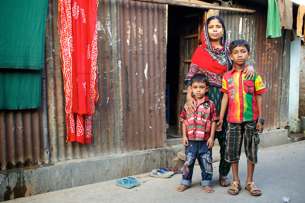 Jahanara with her two sons Jahidul Islam, age 9 and Jahirul Islam, age 5, outside their home in 36 Bari Colony. <br />