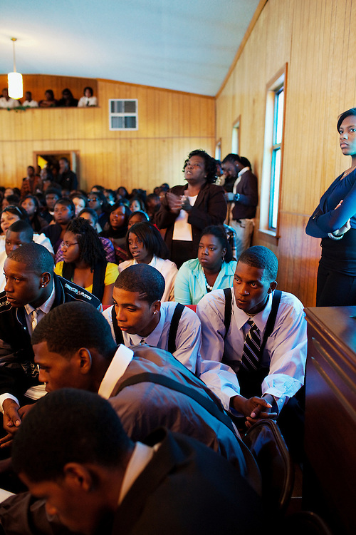 "Friends and family of Demetrius ""Butta"" Anderson, 18, gather at McKinney Chapel in the Baptist Town neighborhood of Greenwood, Mississippi on Friday, November 5, 2010 for his funeral. Butta was shot and killed on October 27, 2010."