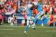 Los Angeles Chargers cornerback Casey Hayward (26) leaps and celebrates with Los Angeles Chargers rookie defensive back Desmond King (20) after intercepting a fourth quarter pass at the Chargers 8 yard line stopping a potential Denver Broncos scoring drive during the 2017 NFL week 7 regular season football game against the Denver Broncos, Sunday, Oct. 22, 2017 in Carson, Calif. The Chargers won the game in a 21-0 shutout. (©Paul Anthony Spinelli)