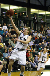 16 December 2006: Anthony Gunnell one hands a lay up uncontested from the middle of the lane. The University of Chicago Maroons upset  the Illinois Wesleyan Titans 64 - 60 at the Shirk Center in Bloomington Illinois.<br />