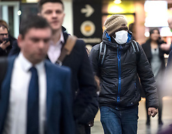 © Licensed to London News Pictures. 05/03/2020. London, UK. A Commuter arriving at Euston Station in London during rush hour, wearing A medical mask. New cases of the COVID-19 strain of Coronavirus are being reported daily as the government outlines it's plans for controlling the outbreak. Photo credit: Ben Cawthra/LNP