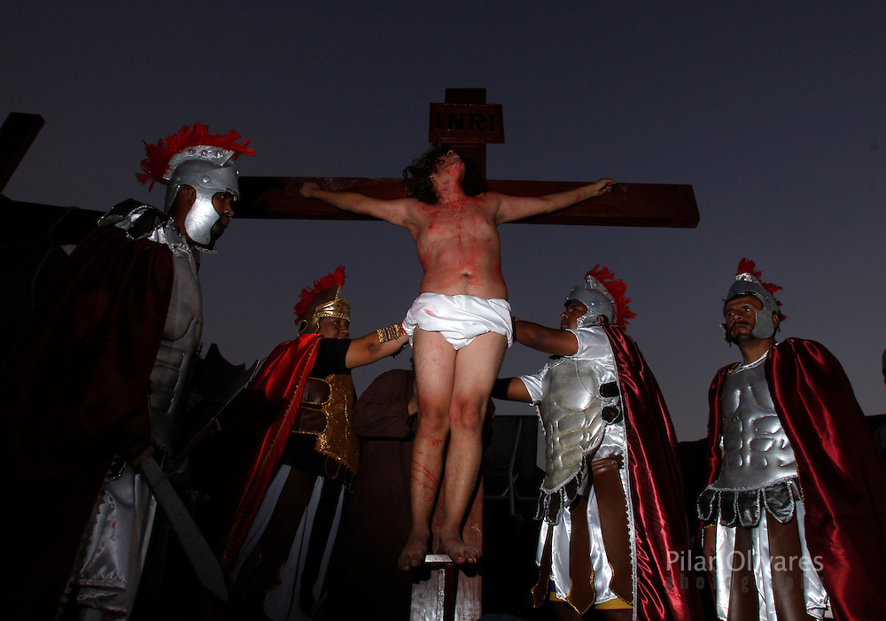 An actor playing the role of Jesus Christ hangs on a cross in an re-enactment of the crucifixion of Jesus Christ on Good Friday during Holy Week on the outskirts of Lima April 2, 2010.