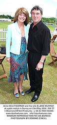 Actor BILLY MURRAY and his wife ELAINE MURRAY at a polo match in Surrey on 23rd May 2004.PUI 77