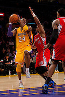 25 February 2011: Guard Kobe Bryant of the Los Angeles Lakers looks to pass the ball while being guarded by Randy Foye of the Los Angeles Clippers during the second half of the Lakers 108-95 victory over the Clippers at the STAPLES Center in Los Angeles, CA.