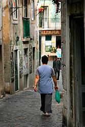 PORTUGAL LISBON 6OCT06 - Narrow lanes in Alfama, Lisbon's traditional quarter and originally a moorish settlement.. . jre/Photo by Jiri Rezac. . © Jiri Rezac 2006. . Contact: +44 (0) 7050 110 417. Mobile:  +44 (0) 7801 337 683. Office:  +44 (0) 20 8968 9635. . Email:   jiri@jirirezac.com. Web:    www.jirirezac.com. . © All images Jiri Rezac 2006 - All rights reserved.
