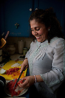 Happy woman preparing food in kitchen