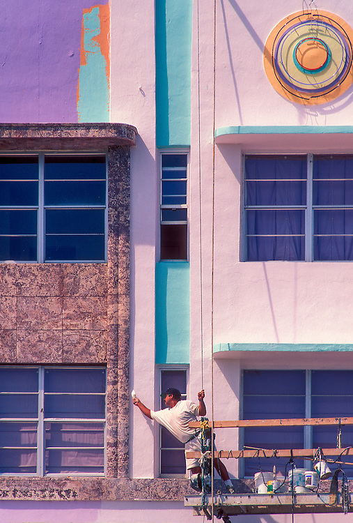 In the early 1990s, during Miami's historic South Beach Revival, a worker repaints the Art Deco-style Cardozo Hotel, designed in 1939 by Henry Hohauser. <br />