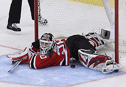 Mar 25, 2010; Newark, NJ, USA; New Jersey Devils goalie Martin Brodeur (30) lies on the ice after the game winning goal by New York Rangers center Erik Christensen (26) during the overtime shootout at the Prudential Center. The Rangers won 4-3 in an overtime shootout.
