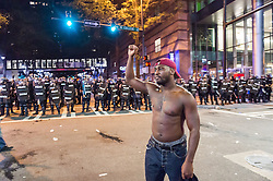 September 21, 2016 - Charlotte, North Carolina, U.S. - Protestors confront police along Trade Street during a protest and eventual riot in uptown. This is the second day of violence that erupted after a police officer's fatal shooting of an African-American man Tuesday afternoon. (Credit Image: © Sean Meyers via ZUMA Wire)