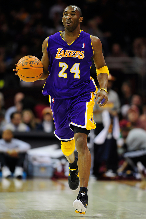 Feb. 16, 2011; Cleveland, OH, USA; Los Angeles Lakers shooting guard Kobe Bryant (24) makes his way down court during the first quarter against the Cleveland Cavaliers at Quicken Loans Arena. Mandatory Credit: Jason Miller-US PRESSWIRE