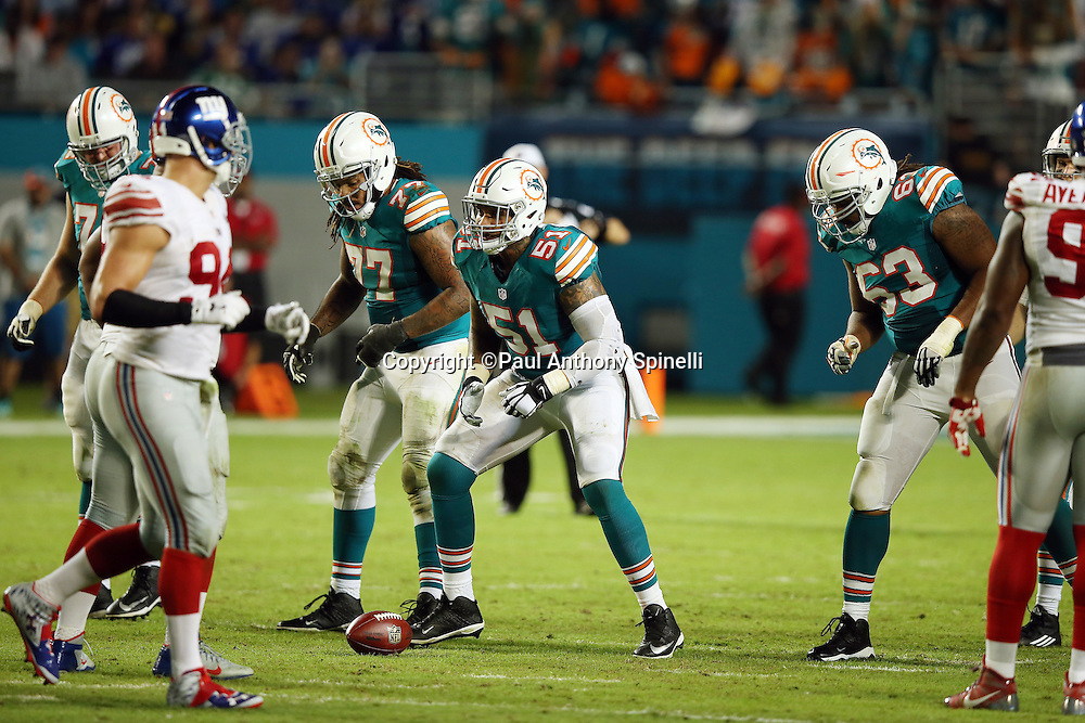 Miami Dolphins center Mike Pouncey (51) gets set during the NFL week 14 regular season football game against the New York Giants on Monday, Dec. 14, 2015 in Miami Gardens, Fla. The Giants won the game 31-24. (©Paul Anthony Spinelli)