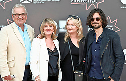 Edinburgh International Film Festival, Wednesday, 27th June 2018<br /> <br /> OBEY (UK PREMIERE)<br /> <br /> Pictured:  Sophie Kennedy Clark (2nd right) with (l to r) her father Francis Clark, mother Fiona Kennedy (daughter of Scottish singer Calum Kennedy) and Australian actor Luke Arnold<br /> <br /> (c) Alex Todd | Edinburgh Elite media
