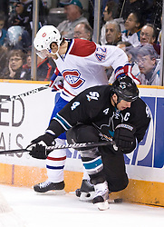 March 4, 2010; San Jose, CA, USA; Montreal Canadiens center Dominic Moore (42) checks San Jose Sharks defenseman Rob Blake (4) during the first period at HP Pavilion.  San Jose defeated Montreal 3-2. Mandatory Credit: Jason O. Watson / US PRESSWIRE