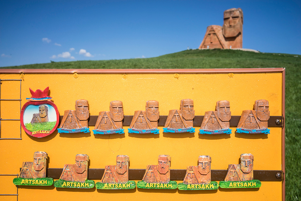 STEPANAKERT, NAGORNO-KARABAKH - APRIL 18: Souvenir magnets for sale at the Tatik Papik monument, a popular symbol of Nagorno-Karabakh, on April 18, 2015 in Stepanakert, Nagorno-Karabakh. Since signing a ceasefire in a war with Azerbaijan in 1994, Nagorno-Karabakh, officially part of Azerbaijan, has functioned as a self-declared independent republic and de facto part of Armenia, with hostilities along the line of contact between Nagorno-Karabakh and Azerbaijan occasionally flaring up and causing casualties. (Photo by Brendan Hoffman/Getty Images) *** Local Caption ***