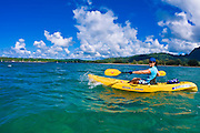 Woman kayaking on Hanalei Bay, Island of Kauai, Hawaii