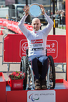 IPC World Cup - Men's T51-T52 event third placed athlete Rob Smith of Great Britain on the podium at the Virgin Money London Marathon 2014 at the finish line on Sunday 13 April 2014<br />