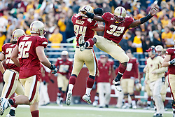 November 20, 2010; Chestnut Hill, MA, USA;  Boston College Eagles linebacker Mark Herzlich (94) celebrates with linebacker Kevin Pierre-Louis (32) after intercepting a pass against the Virginia Cavaliers during the fourth quarter at Alumni Stadium.  Boston College defeated Virginia 17-13.