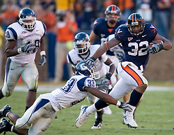 Virginia running back Keith Payne (32) stiff arms Connecticut safety Robert Vaughn (33)...The Virginia Cavaliers defeated the Connecticut Huskies 17-16 at Scott Stadium in Charlottesville, VA on October 13, 2007