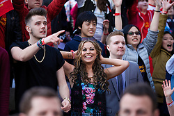 LIVERPOOL, ENGLAND - Thursday, April 10, 2014: Fans at the launch of the new Liverpool Warrior home kit for 2014/2015 at the Liverpool One shopping centre. (Pic by David Rawcliffe/Propaganda)
