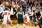 Northridge student section celebrates Pete Smith's (24) last second 3-pointer, which tied the score at 39-39 and sent the game into over time, during a semifinal 4A sectional boys basketball game Friday, March 6, 2015, at North Side Gym in Elkhart. Northridge beat Goshen 51-44 in overtime.