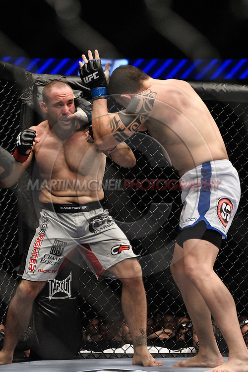 """LONDON, ENGLAND, JUNE 7, 2008: Jason Lambert (facing) and Luiz Cane trade blows and during """"UFC 85: Bedlam"""" inside the O2 Arena in Greenwich, London on June 7, 2008."""