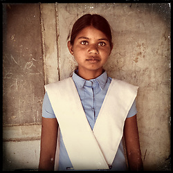 iPhone portrait of Jyoti Bairwa, 12, who refused her marriage after attending the Pehchan Project in Rajasthan, India, April 3, 2013. <br /> <br /> Under Indian law, children younger than 18 cannot marry. Yet in a number of India's states, at least half of all girls are married before they turn 18, according to statistics gathered in 2012 by the United Nations Population Fund (UNFPA). However, young girls in the Indian state of Rajasthan—and even a few boys—are getting some help in combatting child marriage. In villages throughout Tonk, Jaipur and Banswara districts, the Center for Unfolding Learning Potential, or CULP, uses its Pehchan Project to reach out to girls, generally between the ages of 9 and 14, who either left school early or never went at all. The education and confidence-building CULP offers have empowered young people to refuse forced marriages in favor of continuing their studies, and the nongovernmental organization has provided them with resources and advocates in their fight.