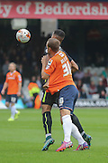 York City forward Vadaine Oliver has a hold of Luton Town defender Luke Wilkinson shirt during the Sky Bet League 2 match between Luton Town and York City at Kenilworth Road, Luton, England on 10 October 2015. Photo by Simon Davies.
