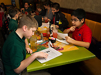 Jonathan and Ricky look over the menu at Restaurante El Jimador in Belmont Thursday afternoon during Holy Trinity School's field trip with fellow 4th and 5th graders from Mrs. McKinney's Spanish class.  (Karen Bobotas/for the Laconia Daily Sun)