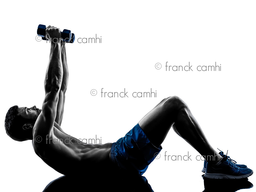 one caucasian man exercising fitness crunches exercises in studio silhouette isolated on white background
